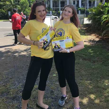 United Australia Party 'volunteers' handing out how-to-vote cards at the Clifton Beach polling booth in the seat of Leichhardt were reportedly hired from a modelling agency by Clive Palmer. PICTURE: SUPPLIED