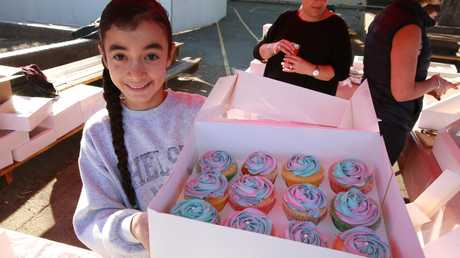 Zoe Gizariotis, 11, with these rocking cupcakes she made for her school's cake stall at Willoughby Public School. Picture: AAP