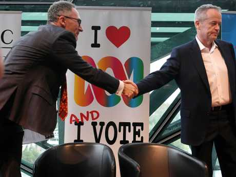 Opposition Leader Bill Shorten may have to show Greens leader Richard Di Natale a little more love if the election ends in a hung parliament. Picture: AAP