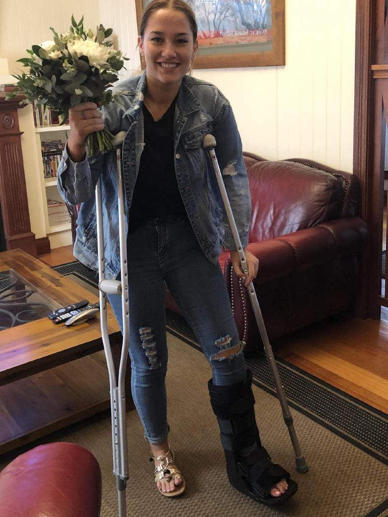 Gordonvale woman Krystal Hadley on crutches with a fractured foot after jumping for the bouquet at her partner's brother's wedding.