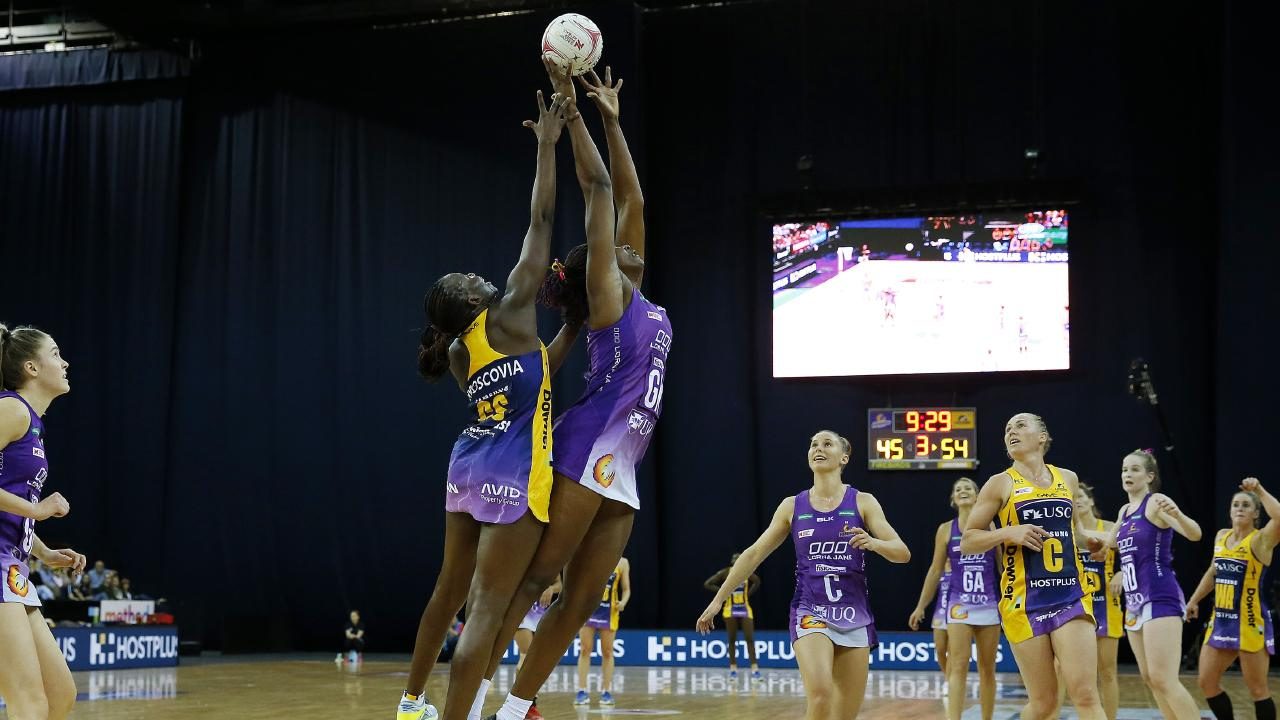 """The Lightning's Peace Proscovia and Firebirds' Romelda Aiken fly high for the ball in the """"Battle of the Bruce""""."""