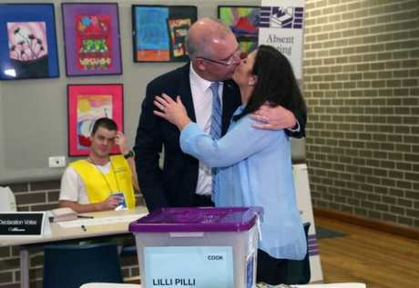 Scott and Jenny cast votes in their seat of Cook