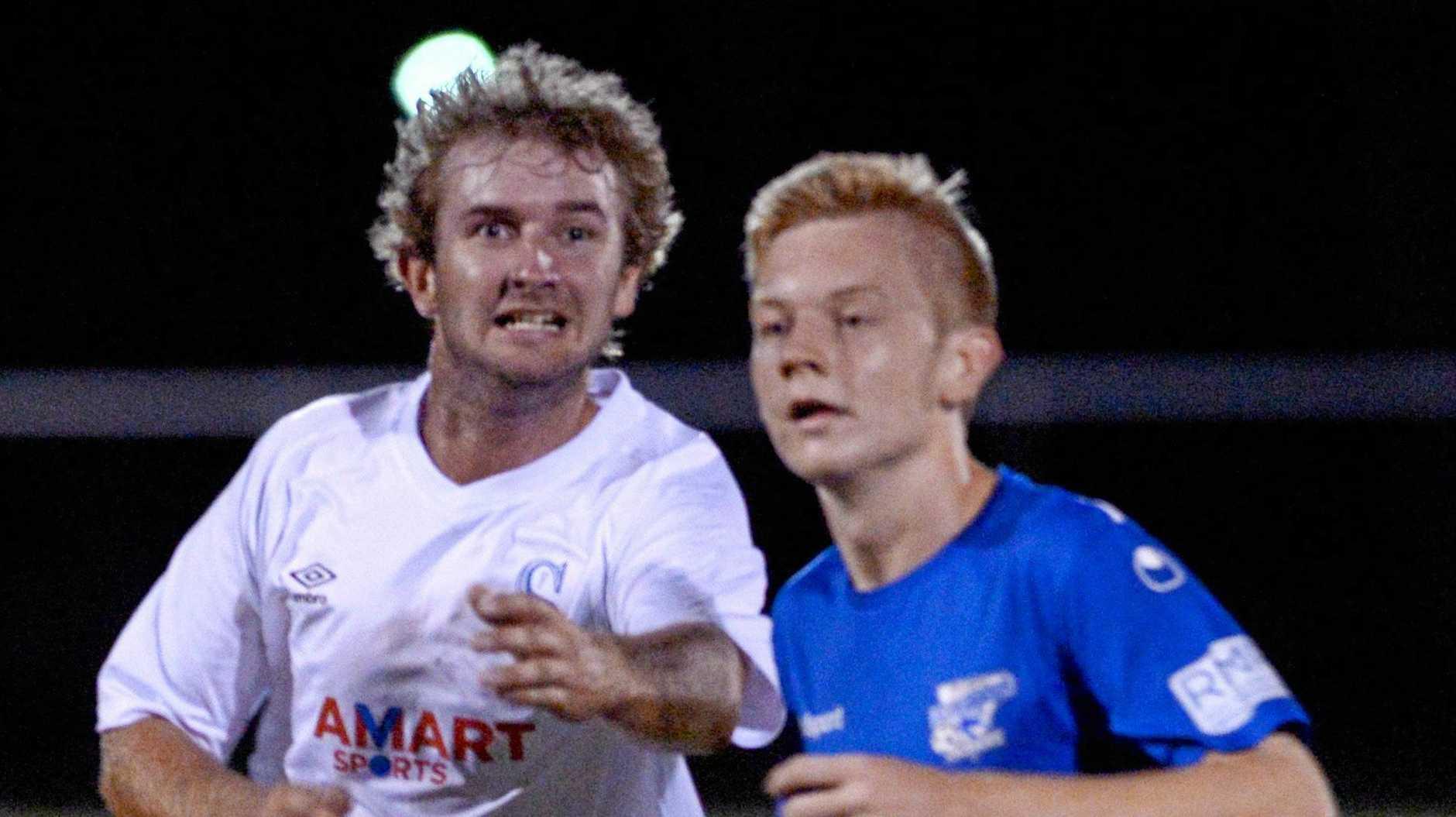 FOOTBALL FFA CUP: Sunbury Blues' Lachlan Reinikka and Bluebirds United's Sam Skinner.