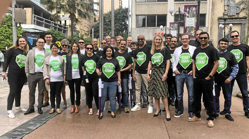 About 30 Sentinel Property Group and Adani staff members wearing #STARTADANI emblazoned shirts marched through the Brisbane CBD  to show support for the Carmichael rail and port project.