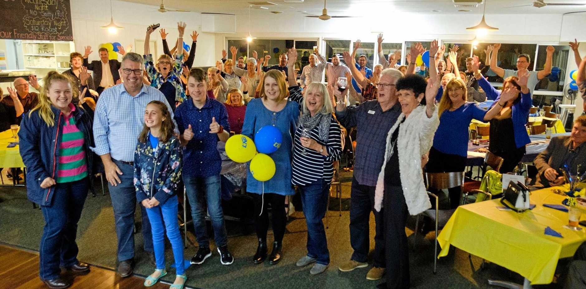 JUBILANT: Keith Pitt celebrates with family and supporters at the Burnett Bowls Club on Saturday. Mr Pitt received about a 6 per cent swing towards him, according to the AEC count.