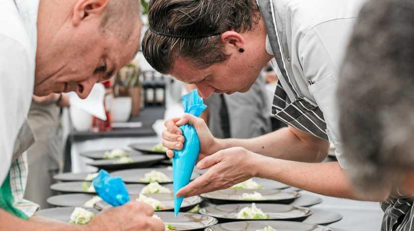 PRECISE: Chefs prepare plates to wow the tastebuds.