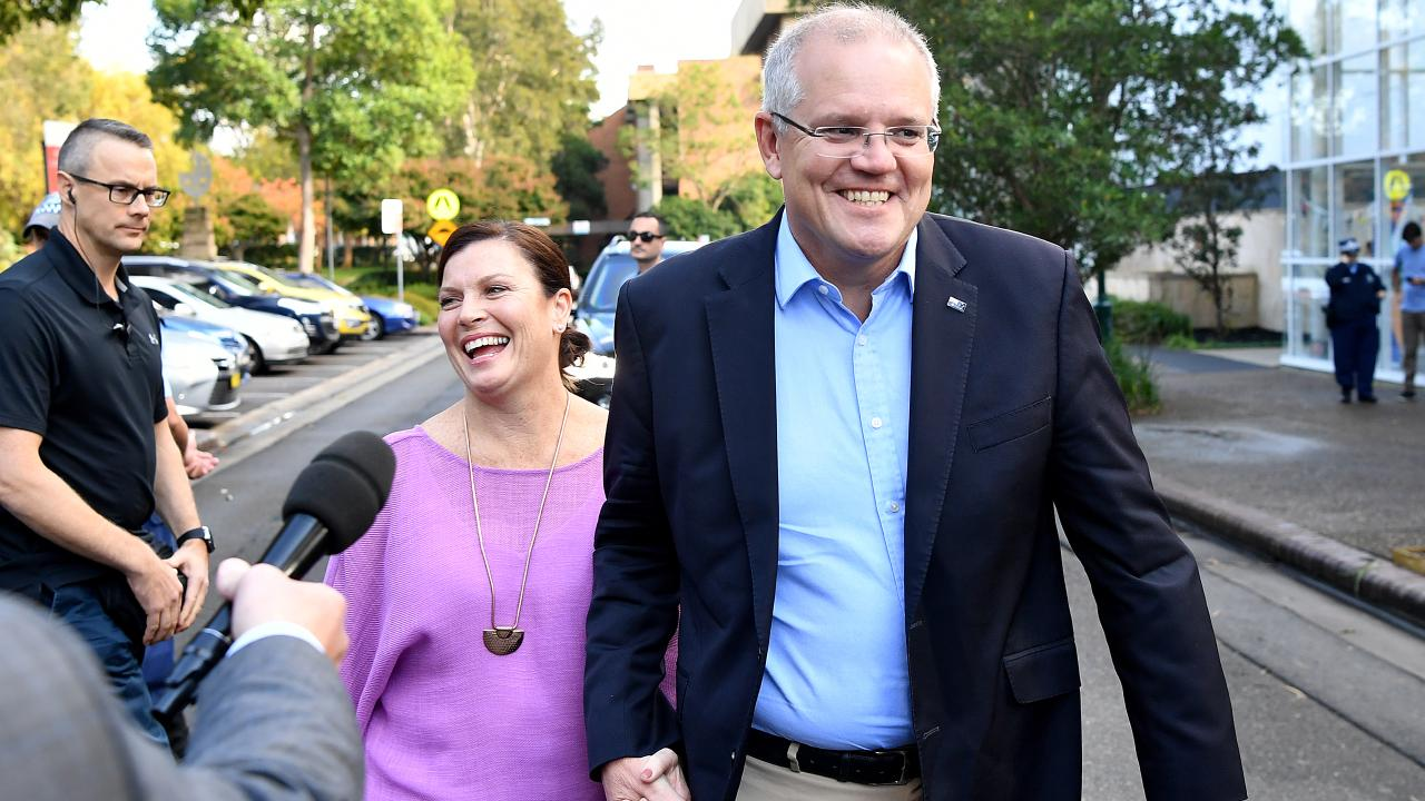 Prime Minister Scott Morrison and wife Jenny speak to the media on Sunday morning. Picture: AAP