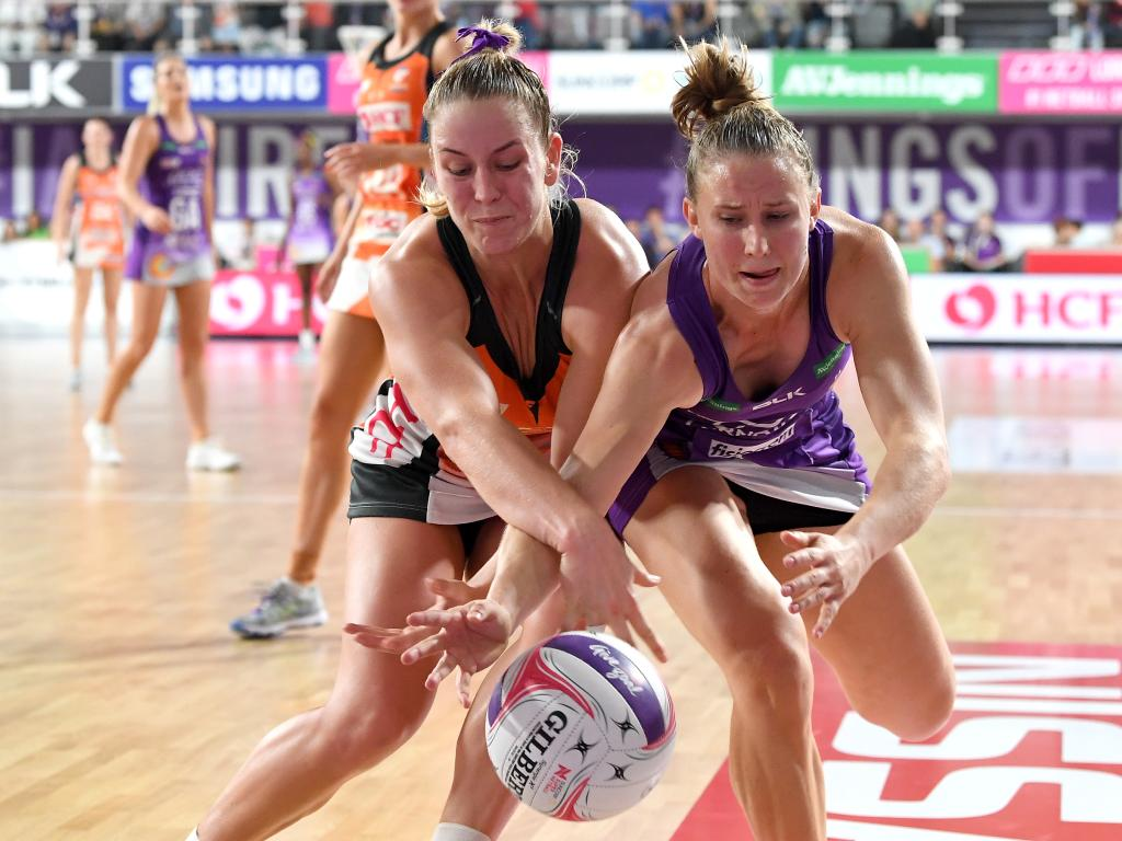 Mahalia Cassidy of the Firebirds and Jamie-Lee Price of the Giants challenge for the ball. Picture: Bradley Kanaris/Getty Images