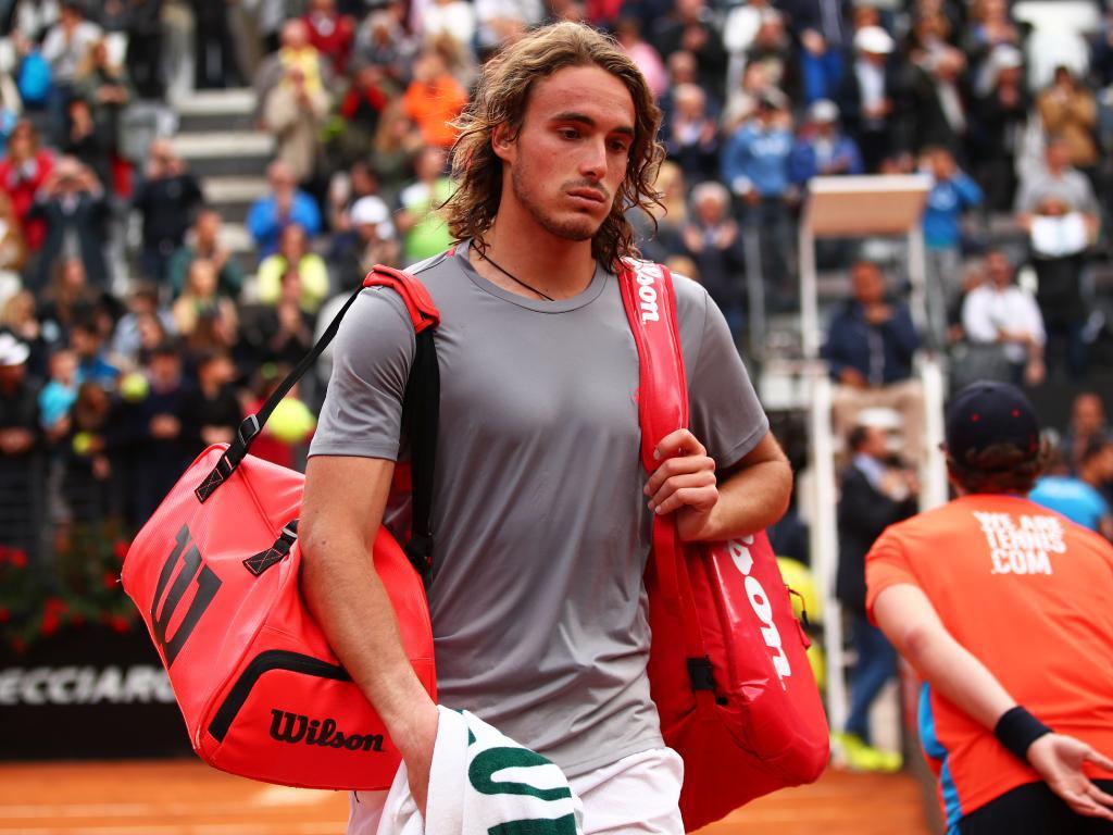 Stefanos Tsitsipas leaves the court.
