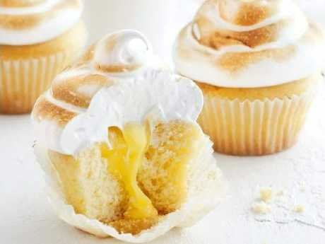 If these sweet, snow-capped lemon meringue cupcakes are good enough for a Lady, they'll be good enough for your office buddies. Picture: Taste.com.au