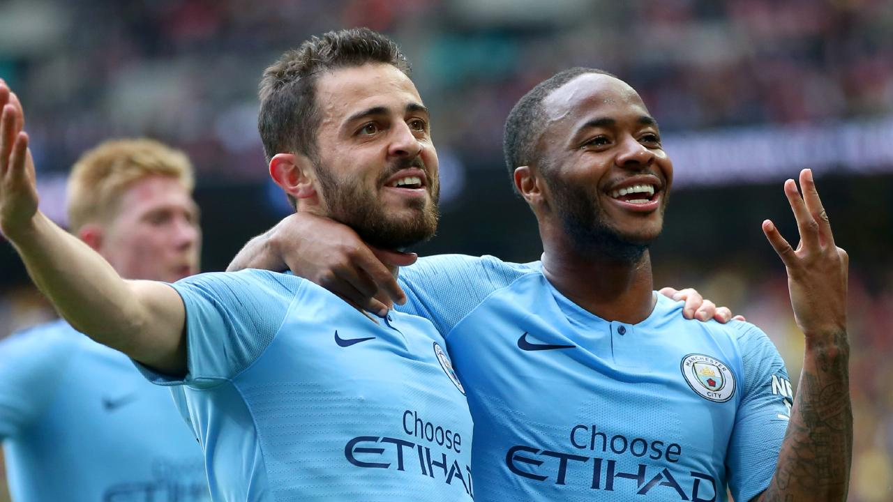 Raheem Sterling of Manchester City celebrates after scoring his team's fifth goal with teammate Bernardo Silva during the FA Cup Final match between Manchester City and Watford at Wembley Stadium. Picture: Getty