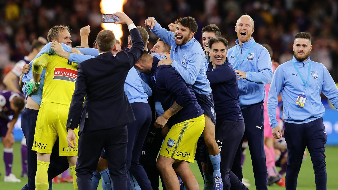 Sydney FC celebrate their big A-League final success.
