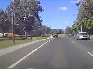 Dangerous driver crosses over lanes