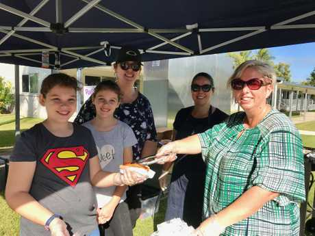 From left, Maya, Evie and Karen Pelchen, Danielle Tasman and Janece Windsor serving up sausages at the Bucasia State School polling station.