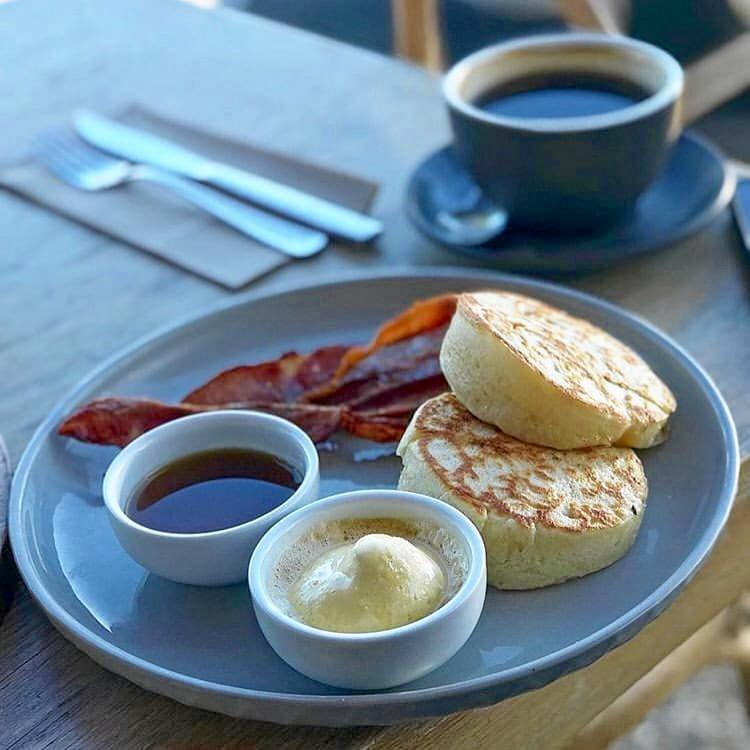 Winter warmer meals at cafes in Toowoomba. Housemade  crumpets with a side of crispy bacon.