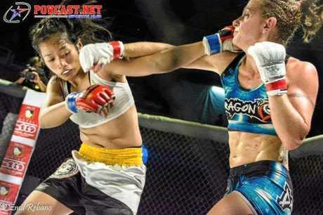 Sunshine Coast MMA fighter Claire Fryer (right) v Jennifer Olsim in the Phillipines, 2016.