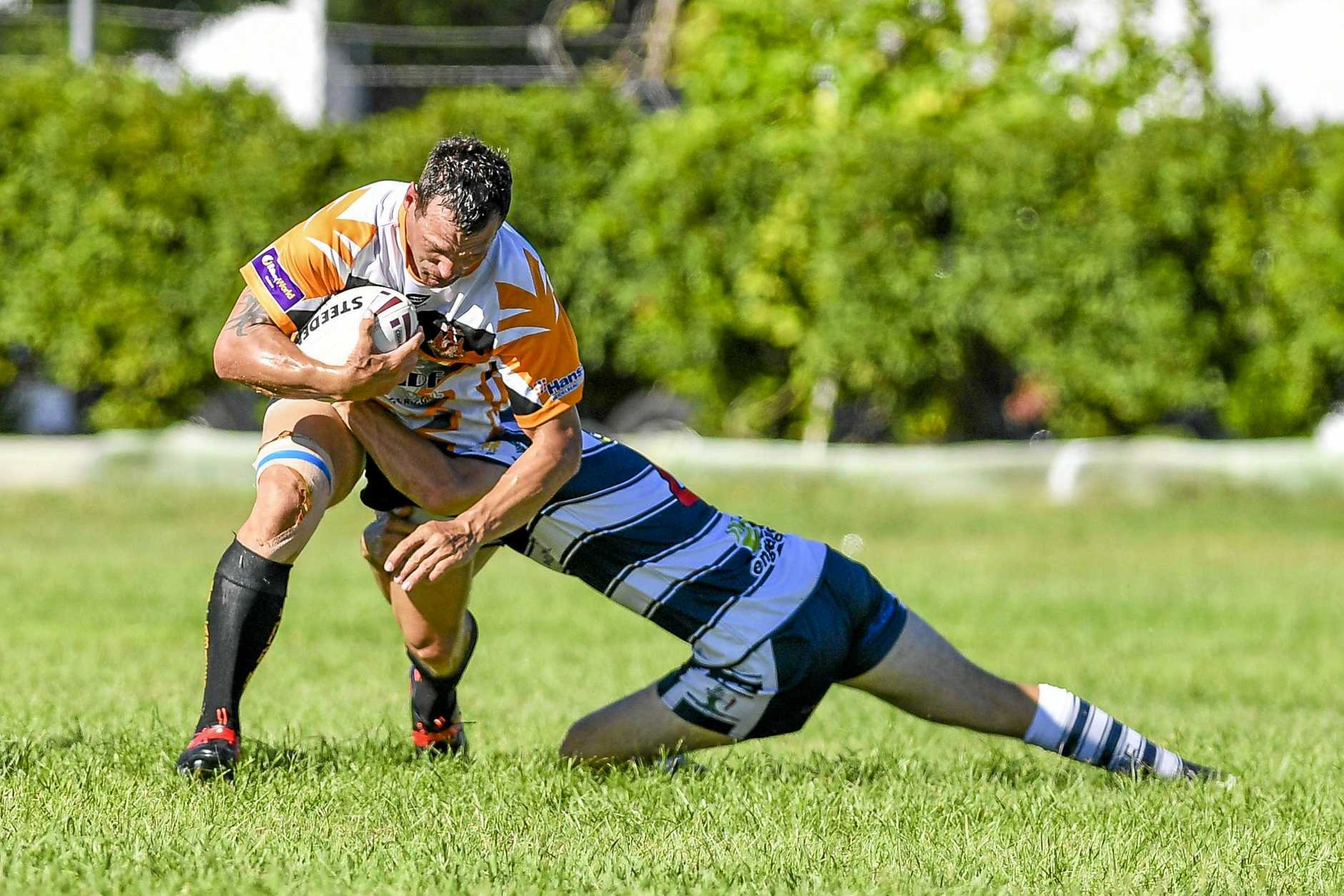 REMATCH: Wallabys' Jason Batchelor is tackled by Gladstone Brothers in their match last March.