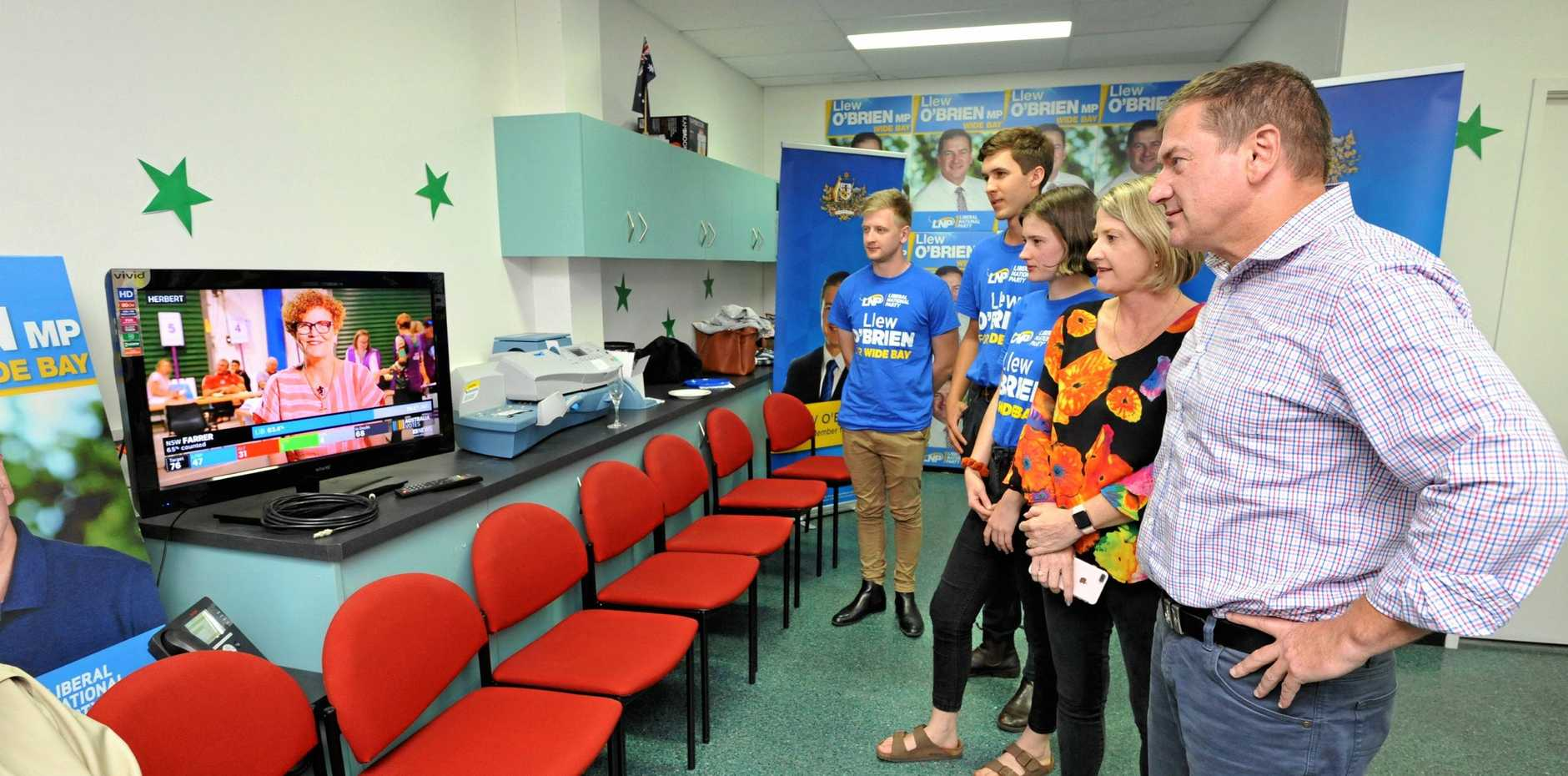 REGION'S WISHLISTS: Wide Bay MP Llew O'Brien and his family watch the election count on TV. The region's business leaders have called on Mr O'Brien and Hinkler MP Keith Pitt to start delivering their infrastructure plans for the Fraser Coast region after the Coalition was swept to victory.