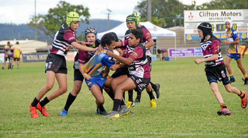 BRAVE EFFORT: Brumbies U14s battle desperately to stop a try.