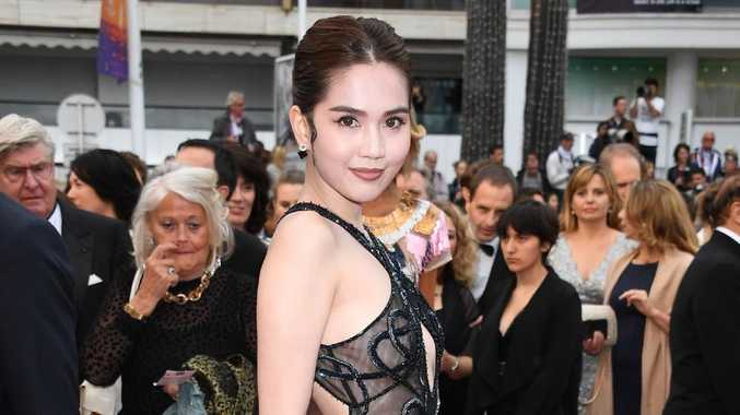 Model flashes G-string in daring dress