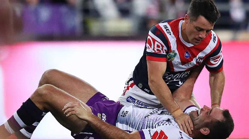 The Roosters' Cooper Cronk and Melbourne Storm skipper Cameron Smith mix it up in last year's grand final.