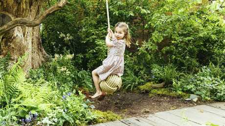 Princess Charlotte, daughter of Prince William and Kate, Duchess of Cambridge plays in the garden.