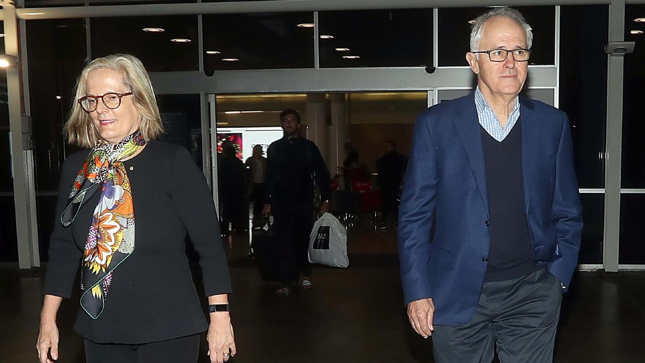 Former prime minister Malcolm Turnbull arrives back on Australian soil with wife Lucy after the Liberals' unexpected election win. Picture: Diimex