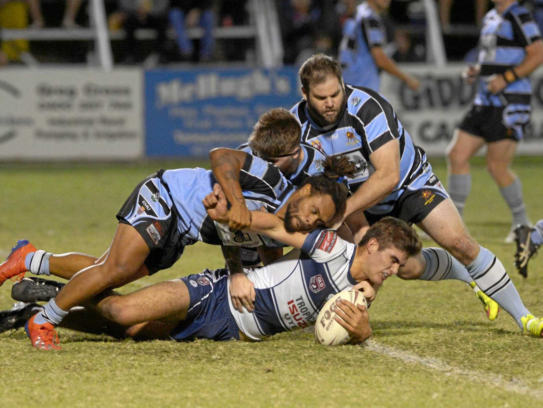 GOOD DEFENCE: Solid Norths defence halts the charge of Rockhampton Brothers' player Roarke Christensen in the A-grade rugby league clash at Victoria Park on Saturday night.