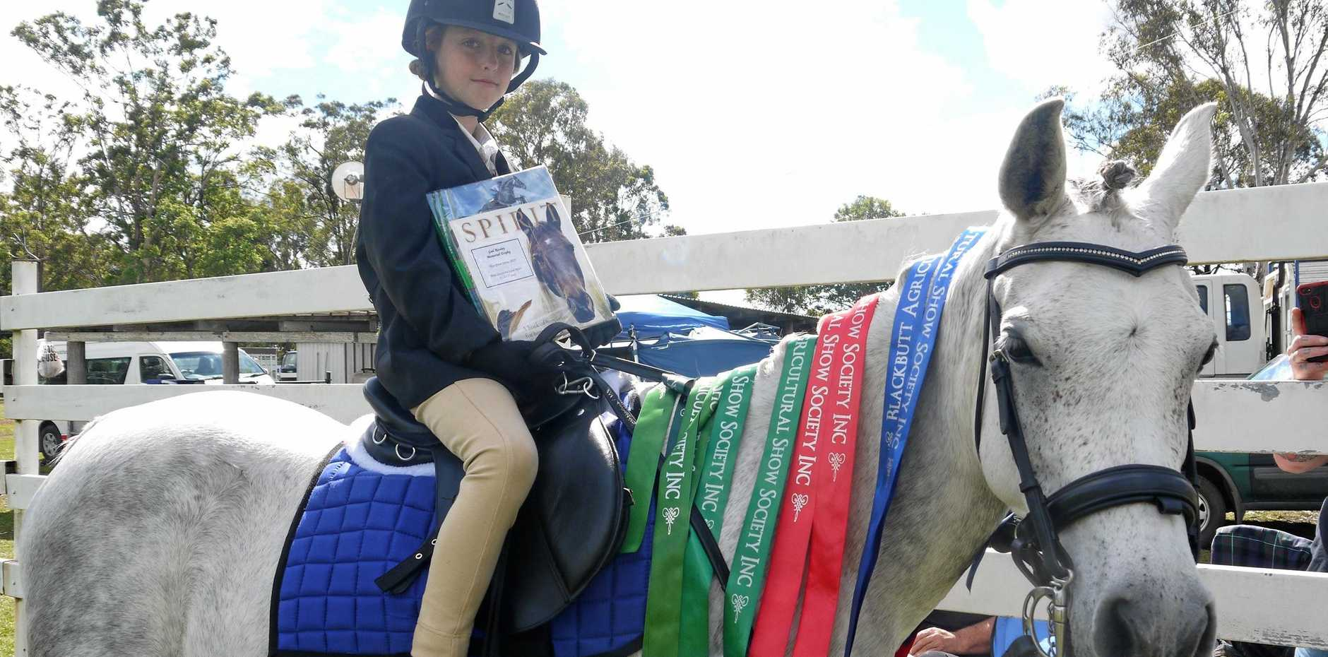 Kyesha Graham and her best friend Sabi show off their winning ribbons from the Blackbutt Show.