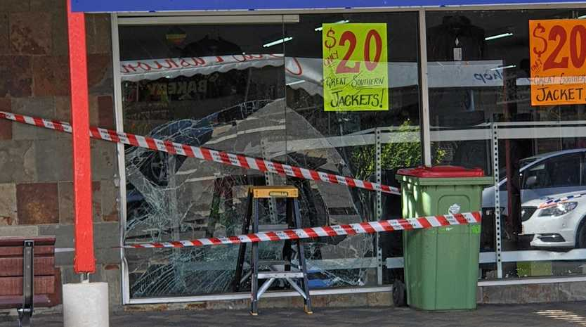 WAYNE'S WINDOW: Natalie McKay came out of a Laidley shop to discover a car had driven into the window of Wayne's World.
