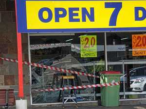 Car smashes through window at popular shop