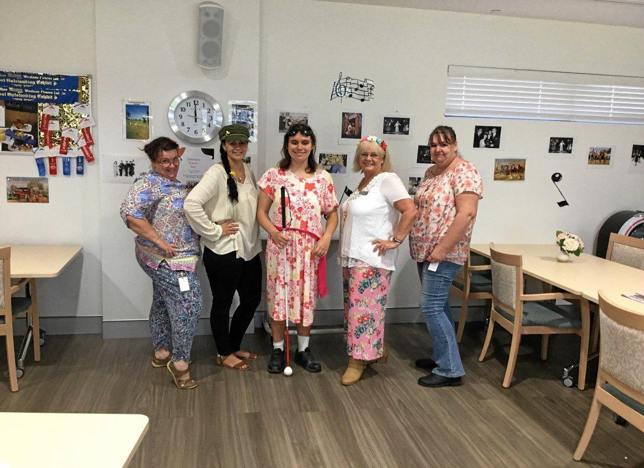 High-school volunteer May (centre) channels Judith Durham with Whiddon staff in their Seekers theme day.