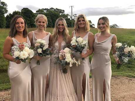 Photos posted to social media show Margot in a bridesmaid dress by Australian label Bec + Bridge. Photo: Facebook/ Brittany Lindores