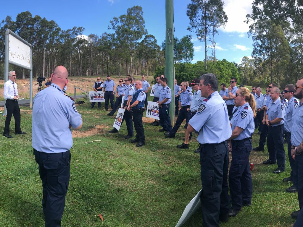 Together branch Secretary Alex Scott (far left) addresses about 100 Wolston Correctional Centre officers who walked off the job.