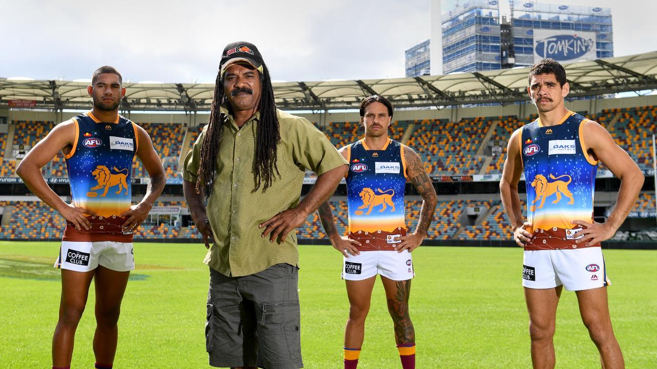 Indigenous guernsey designer Derek Oram with Lions players Cedric Cox, Allen Christensen and Charlie Cameron at the Gabba. Picture: Bradley Kannaris