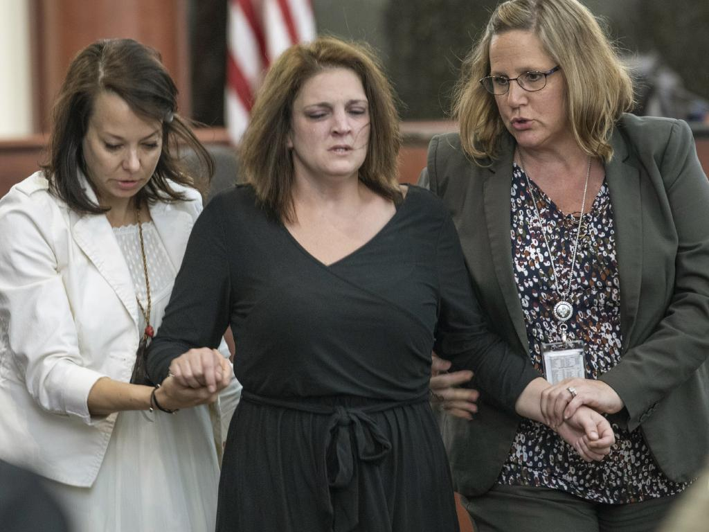 Amber Kyzer is helped out of the courtroom after breaking down on the witness stand while being questioned during the trial of her ex-husband, Tim Jones. Picture: AP