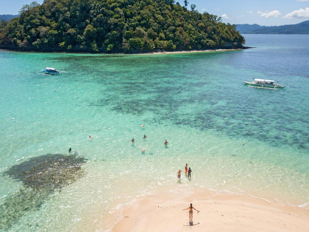 A drone photographs young woman relaxing on tropical beach in the Philippines. Such privacy concerns are now extending to national security. Picture: iStock