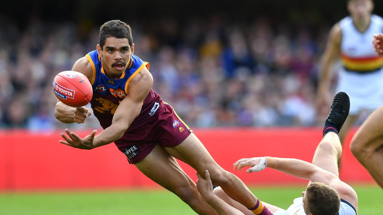 Charlie Cameron gets a handball away during Brisbane's one-point win over Adelaide at the Gabba.. Picture: AAP Image/Darren England