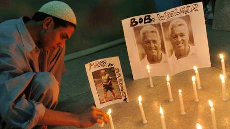 A Pakistani cricket fan lights candles to pay tribute to Woolmer in Karachi.