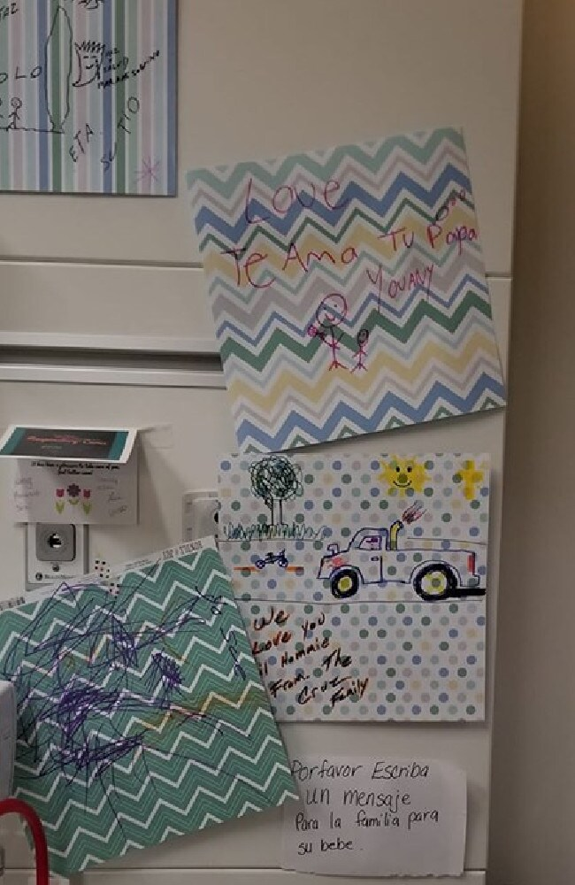 Messages of support hung around the newborn's incubator. Picture: Facebook