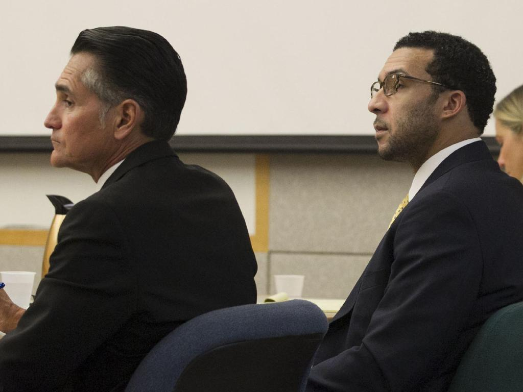 Former NFL football player Kellen Winslow Jr., right, sits with his lawyer Marc Carlo, left. Picture: AP