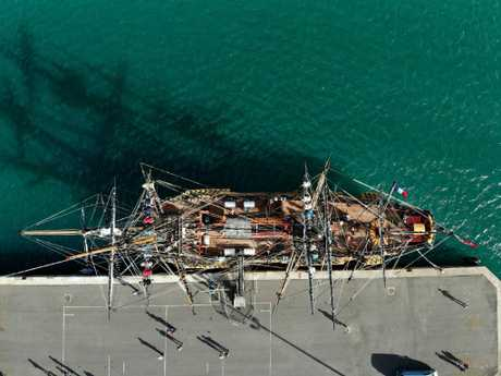The HMB Endeavour photographed by drone at a dock in Nouma. Drone photos and video from sensitive areas could be being redirected to China. Picture: Toby Zerna