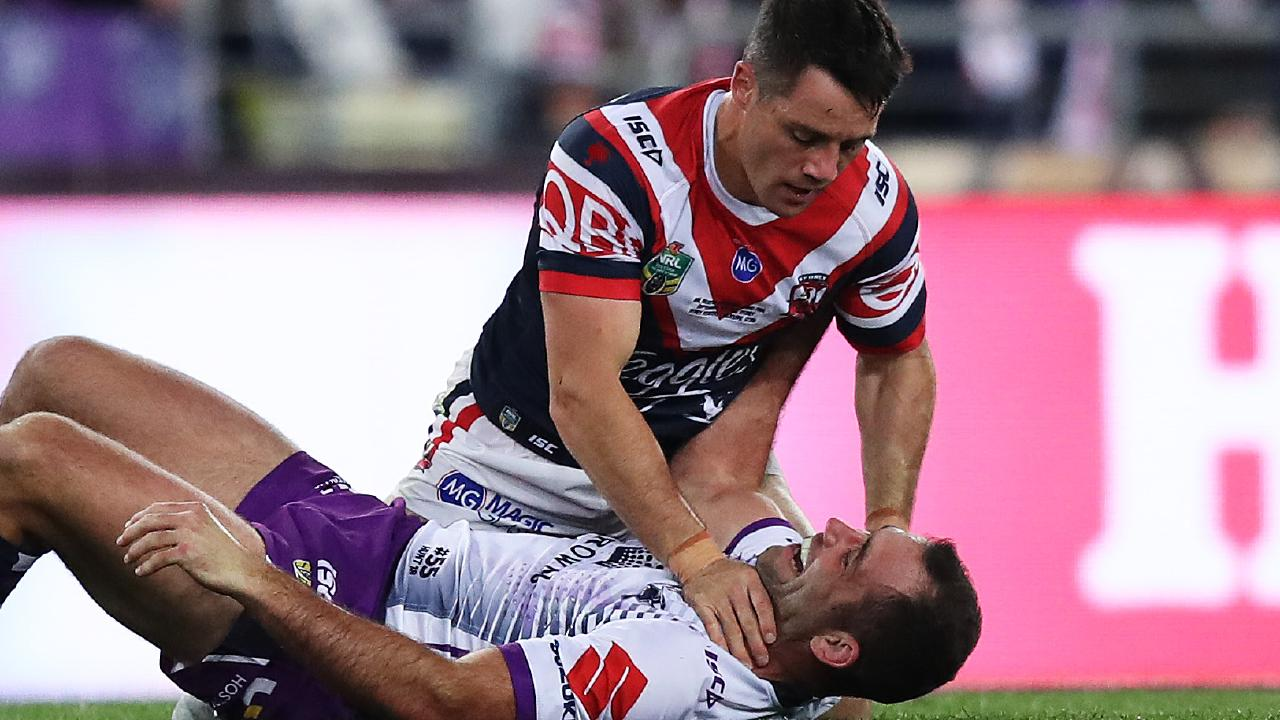 Mate vs mate.  Cooper Cronk and Cameron Smith in last year's NRL grand final.