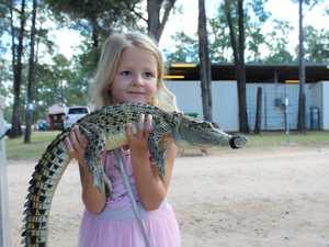 Penny Makin holding Sardine the salt water crocodile