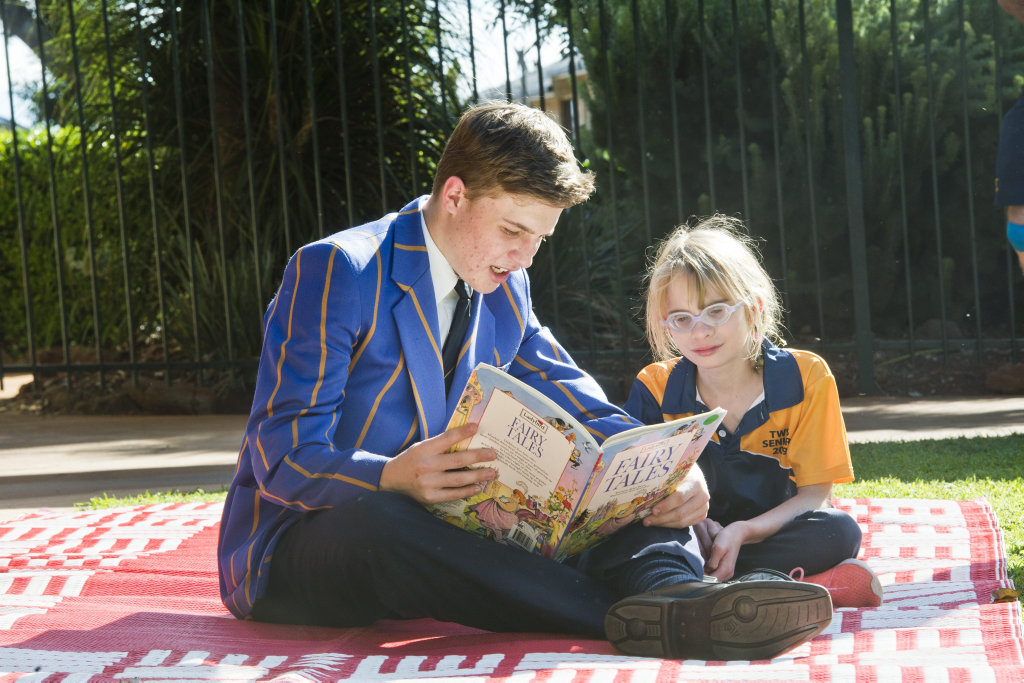 Image for sale: TGS student Jack Sullivan reads to TWSS student Tara. Toowoomba Grammar students visit Toowooomba West Special School every week. Wednesday, 22nd May, 2019.