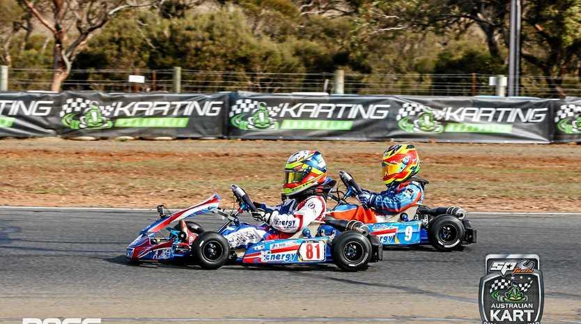 Bundaberg's Ky Burke battles for the lead in the Cadet 9 race in Monarto last weekend.