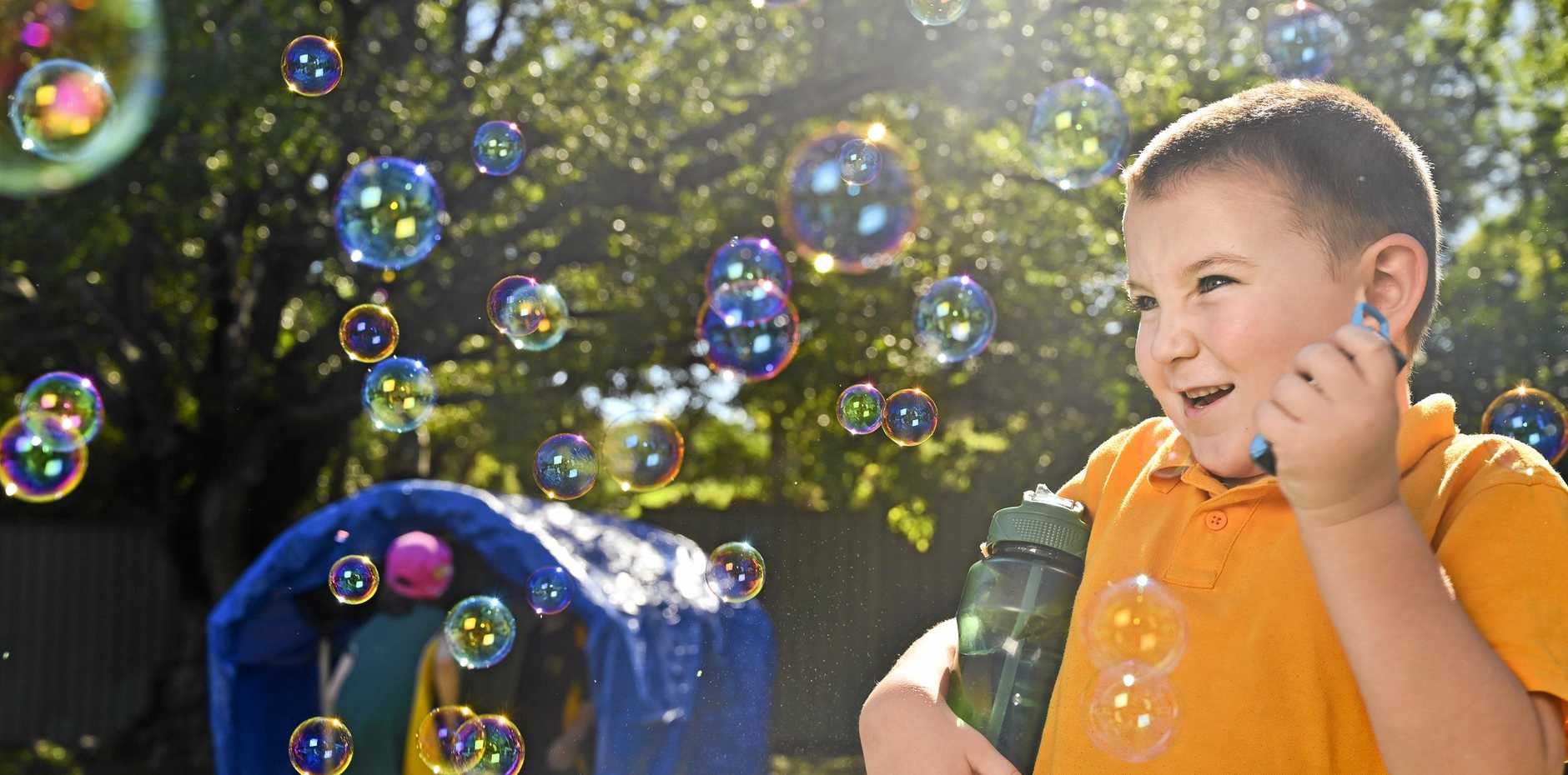 Jake Carter, 5, of Ipswich Special School plays with bubbles at an U8's day for pupils from special schools across Ipswich.