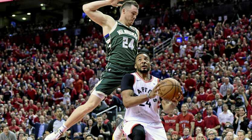 Toronto's Norman Powell heads for the basket as Milwaukee guard Pat Connaughton defends during the second half of game four of the NBA Eastern Conference finals. Picture: Frank Gunn/The Canadian Press/AP
