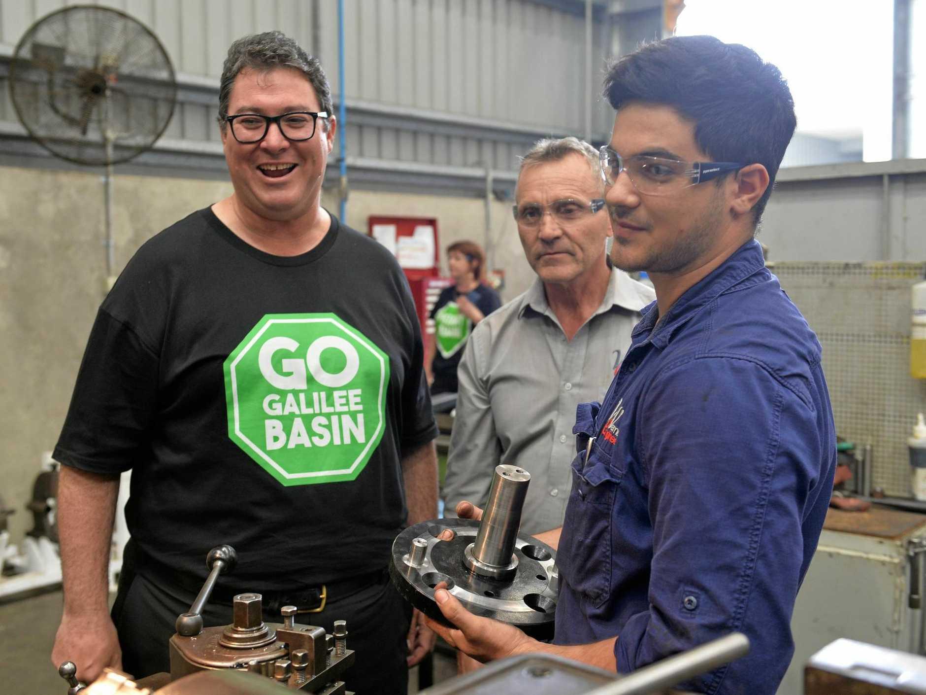 INDUSTRIOUS:  William Hake shows  MP George Christensen and Werner Engineering director Darryl Stark his work.