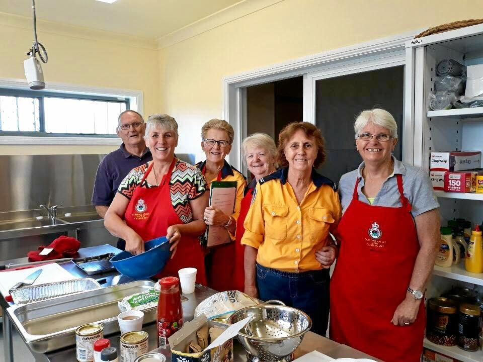 WORKING HARD: The RFS Catering team cook up a storm to keep those on the frontline well fed.